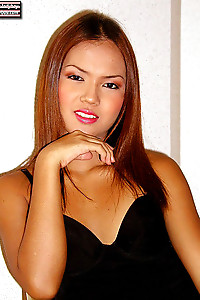 Emmy is a cute little ladyboy from Thailand with a hard penis.