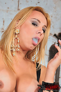 Beautiful Smoking Domina Teases In Her Leather