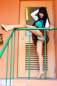 TS Vitress Tamayo shows her panties lifting her skirt on the stairs