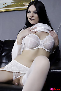 Kinky brunette shemale Hannah Sweden in garter stockings and white lingerie