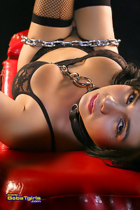 Chained tgirl Stephany Tricks in black stockings