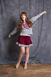 Bailey posing in school sweeter