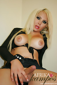 Blond Blue Eyes and Naturally Busty Tranny stroking that fat shecock of hers