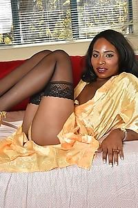 Ebony beauty Megan strips and plays