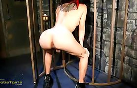 Filthy Adriana plays in the dungeon cage