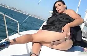 Vaniity naked on yacht deck
