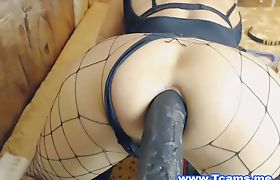 Tranny Inserts Multiple Hige Toys in Her Ass
