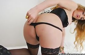 Corset wearing shemale Elle shows off ass and masturbates