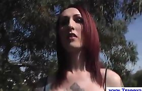 Gothic transsexual plays with her hard nipples outdoor