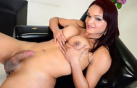 Hot TS Lorraine jerking her big dick until it oozes out cum