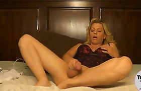 Busty blonde shemale jerks off and pour loads on her palm