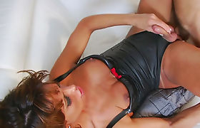 Busty shemale in latex outfit ass rammed on the couch