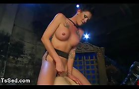 Tranny fucks bound guy in boots on chest