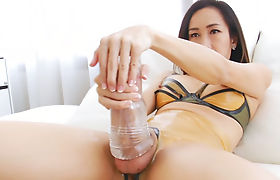Ladyboy with big tits fucks her dick with a fleshlight