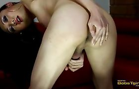 Exotic Venus plays with her large rockhard cock