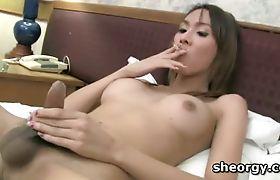 Busty tgirl Miki giving herself a hot handjob