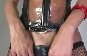 breasty shemale in stockings in leather