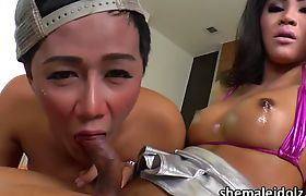 Asian Ladyboys Gift and Candy plays their big dick with a toy