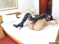 Tranny in latex leather boots playing with herself