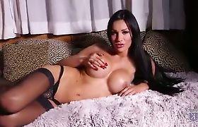 Sexy Kimber pleasuring in stockings