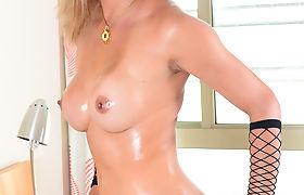 Dirty blonde TS Leticia deepthroats a huge thick cock xxxladyboyz.com
