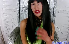 Glamour tgirl teases her butt with dildo