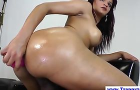Latin transsexual makes love to herself by jerking