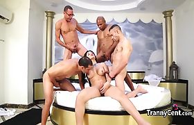Cute tgirl gangbanged by four cocks