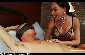 Bound blindfolded guy sucked by tranny in bed