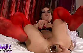 TS Kimberly sticks a massive butt plug in her ass